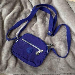 Bright blue mini Kipling crossbody. NWOT.